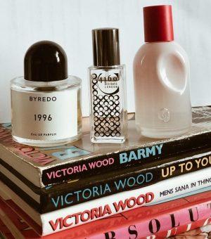 Perfume bottles on book pile